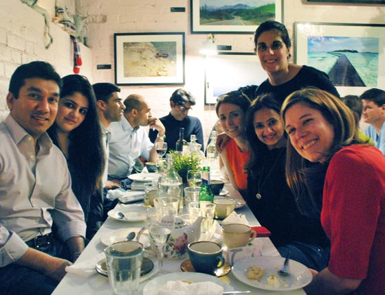 Happy diners with chef Kim