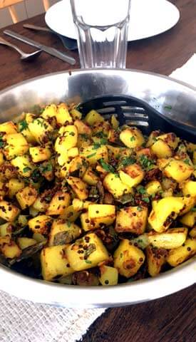Potatoes in mustard seeds and curry leaves